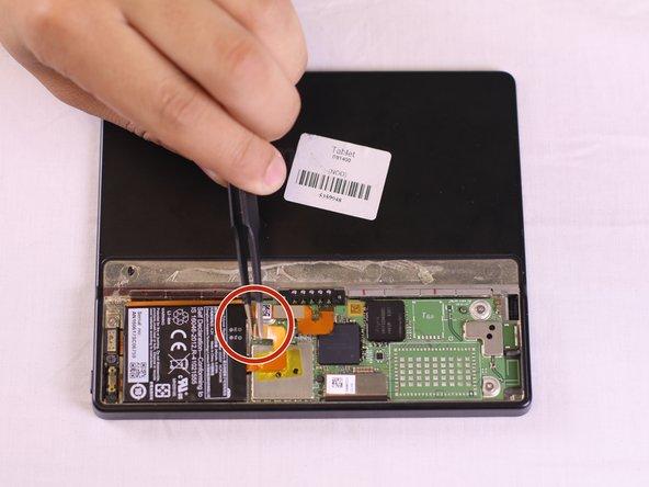 Using tweezers, lift the orange bridge connector off.