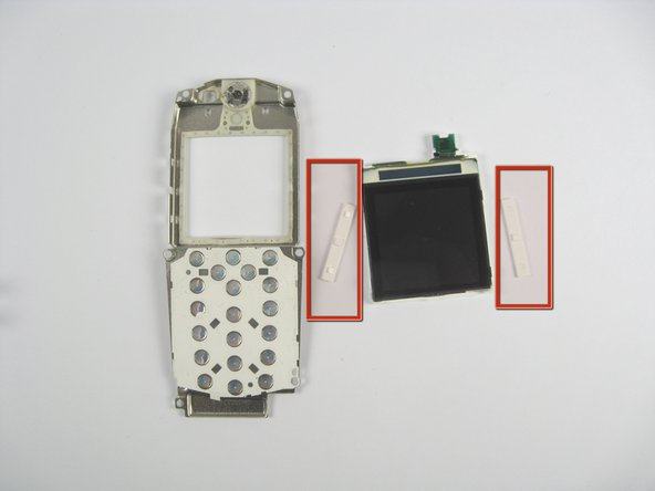 When the screen falls out the assembly, two white tabs will fall out with it.