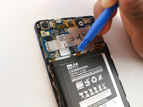 Use the small blue plastic opening tool to lift the contact attached to the battery from the motherboard of the phone.