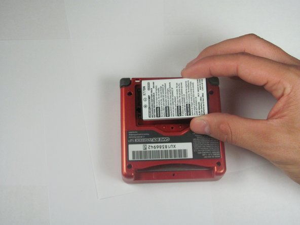 Use your fingers or a plastic opening tool to remove the battery from the device.