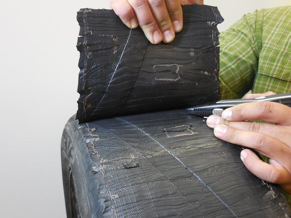 Remove the tread from the tire while scraping underneath the top layer with a knife.