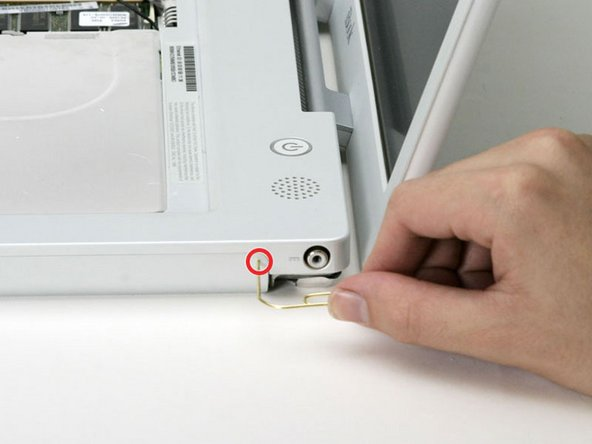 Use a straightened paperclip to open the optical drive tray, and pull it out about halfway.