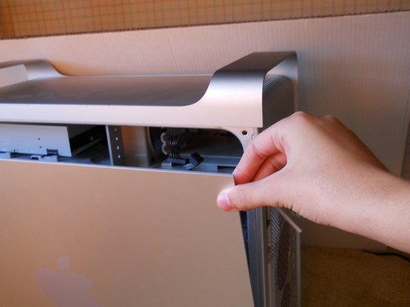 while the lever is up, grip the sides of the panel and pull
