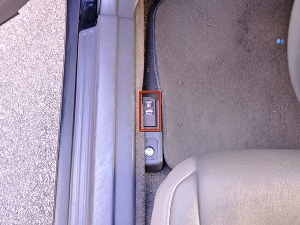 Open the trunk using your key in the trunk key slot or by using the lever under the driver's console.