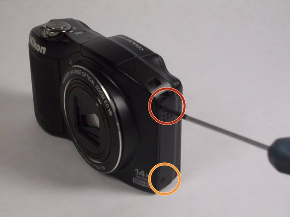 Remove the top (4.20 mm) Phillips #00 screw adjacent  to the mic side of the camera and opposite the battery side.