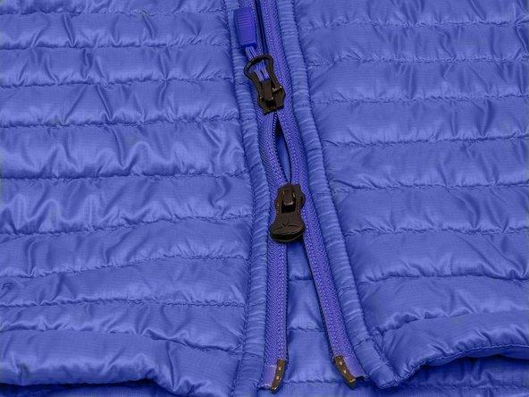 How do I repair a two-way zip slider on my Vaude jacket on a split zip?