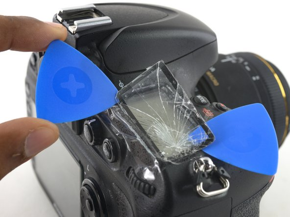 Leave the first opening pick underneath the front-right corner of the glass.