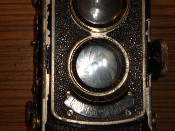 I started by removing the lenses because they needed to be cleaned to check their condition. A camera with broken lenses is more or less worthless and therefore not worth the effort repairing it.