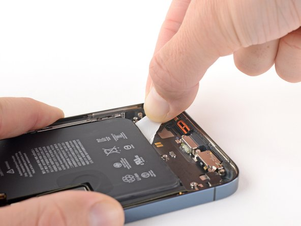 Grab the second pull-tab with your fingers and pull it away from the battery, toward the bottom of the iPhone.