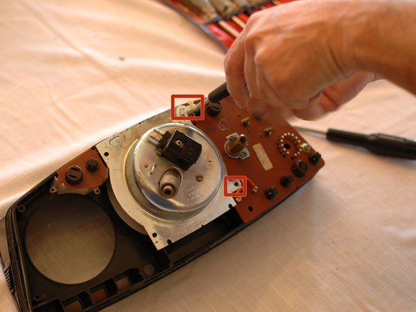 You may need to remove the rheostat that dims the instrument lights first, before removing these last two screws.