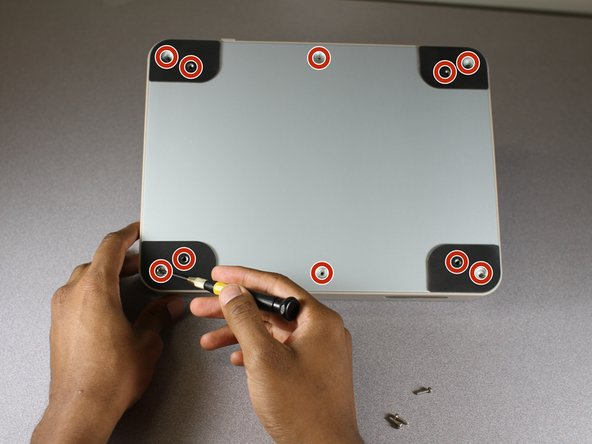 Use a Phillips screwdriver to unscrew all 10 of the 3 mm screws on the back plate.