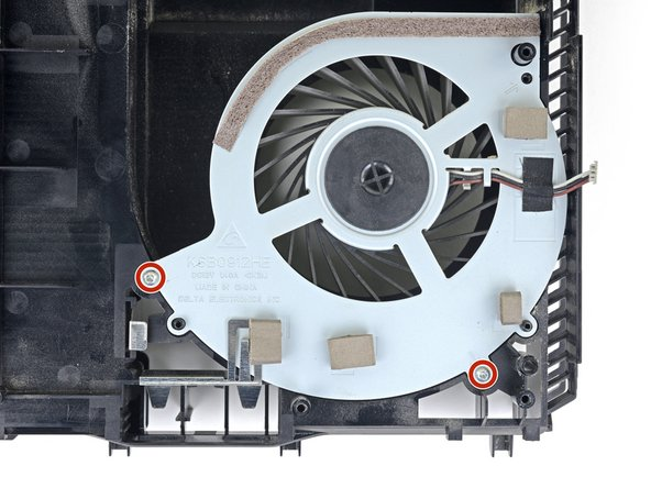 Remove the two 6.2mm Phillips screws from the fan.