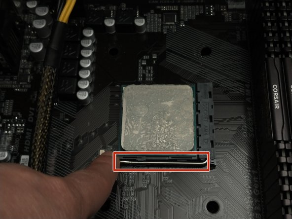 Lift the retention arm to unsecure the CPU.
