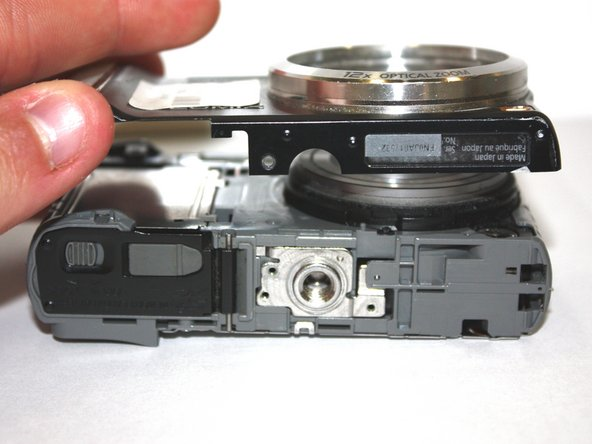 Carefully separate the front of the camera from the main body.