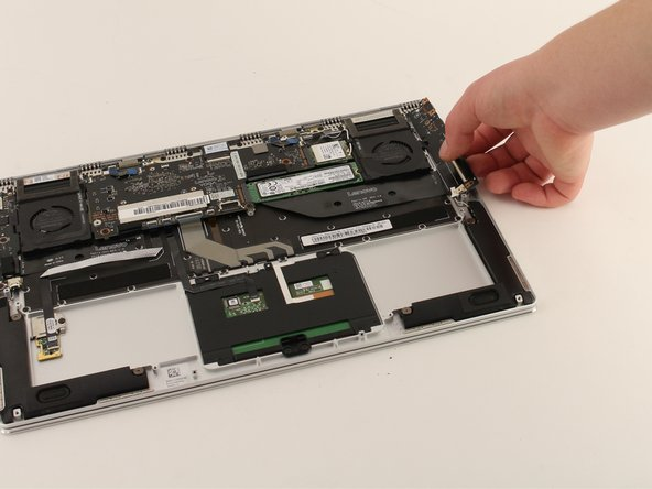 Lift up on the set of ports and remove it from the device.