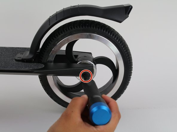 Remove the 4 mm screw in center of the wheel with a 4 mm hex key.