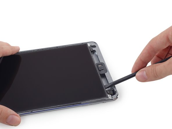 The LCD is secured by mild adhesive that should be loosened before you flip the LCD up from its shield plate.