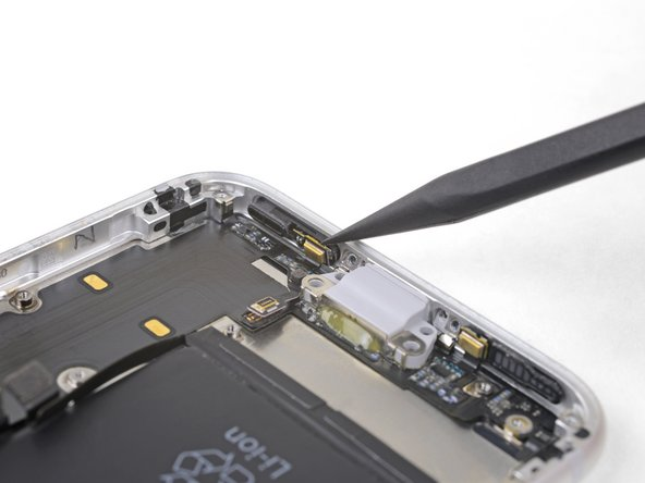 Use the point of a spudger to gently pry the logic-board-side microphone free from the adhesive securing it in place.