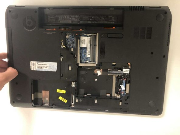 Pull CD drive out to remove.