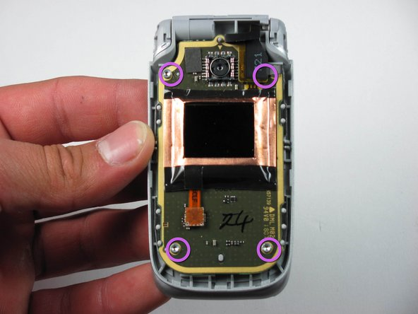 Locate the four screws on the phone.