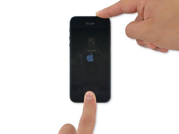 如何强制重启iPhone 5s。