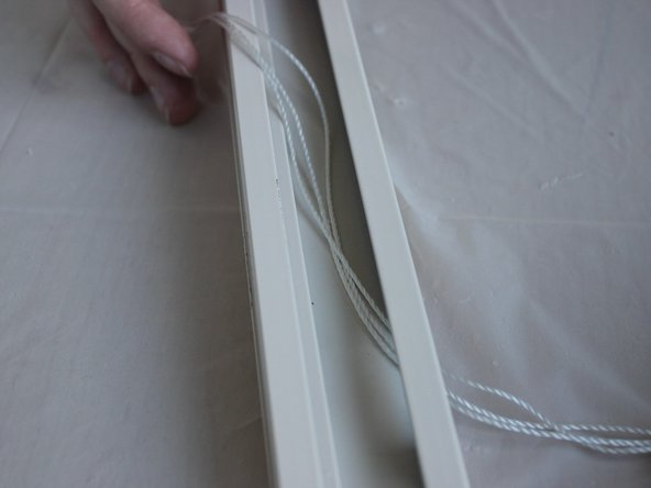 Turn the top rail over so that the top is on the work surface.
