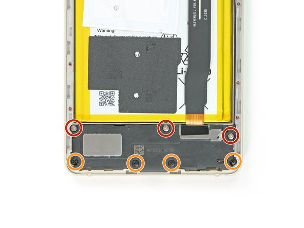 On the bottom of the phone remove the following screws: