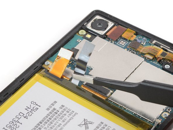 Repeat the previous process with the adhesive tab next to the battery flex cable.