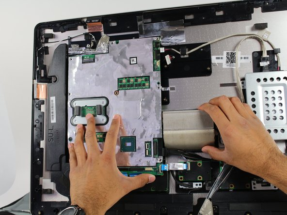 Lift the motherboard just enough to dismount it from the plastic pegs that hold it in place.