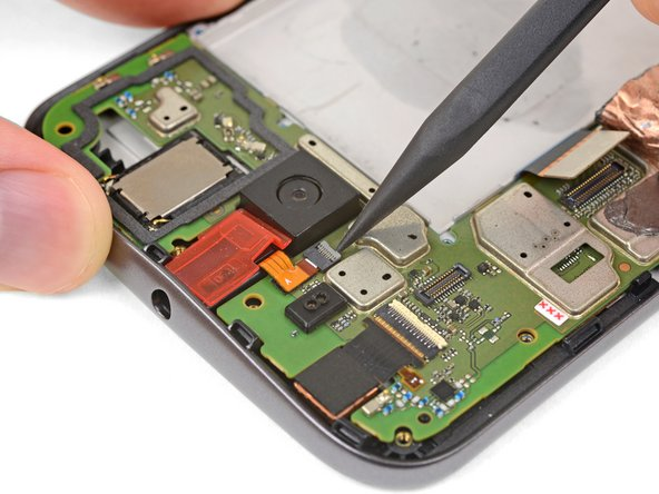 Pry up with your spudger to flip open the locking flap on the headphone jack's ZIF connector.
