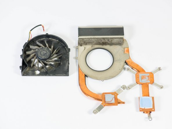 Carefully separate the fan from the heat sink.