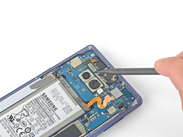 Use the tip of a spudger to pry the front camera connector straight up and out of its socket.