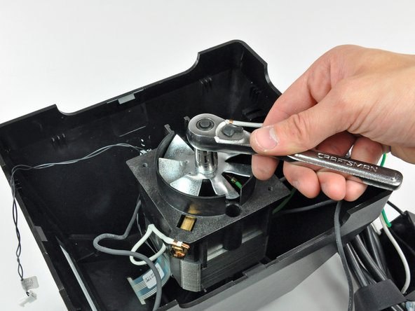 Remove the single nut from the fan end of the shaft.