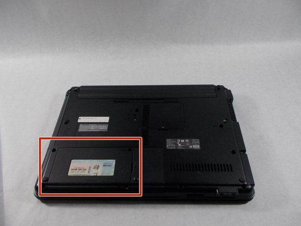 Flip the laptop over to the backside. The Hard Drive is located on the bottom left.