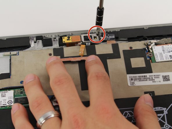 Use a Phillips #00 screwdriver to remove the screw in the corner of the camera.