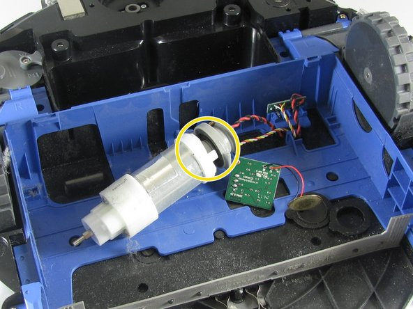 Option A: Some motors can unclip from the wiring harness. Use the spudger to pry the white colored base of the motor from the gray piece on the end.