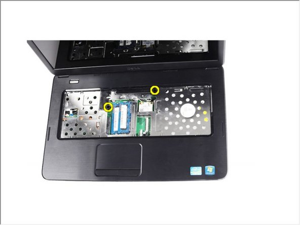 Remove the screws that secure the palm rest to the computer
