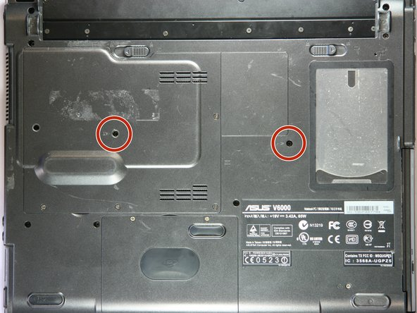 Using a Phillips #0 screwdriver, remove the two screws from the case.