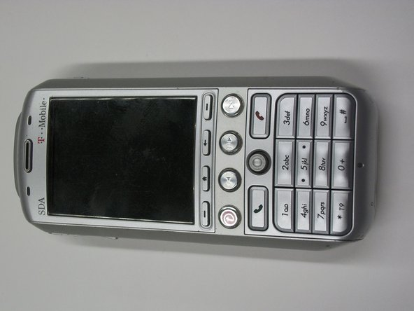 To remove the battery cover, first turn the phone so that the keypad is face down.