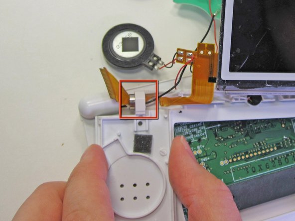 Carefully slide the ribbon cable through the clip.