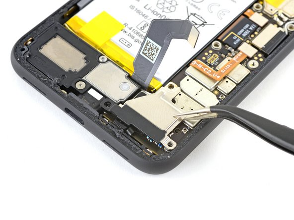 Use a pair of tweezers to remove the vibration motor shield.
