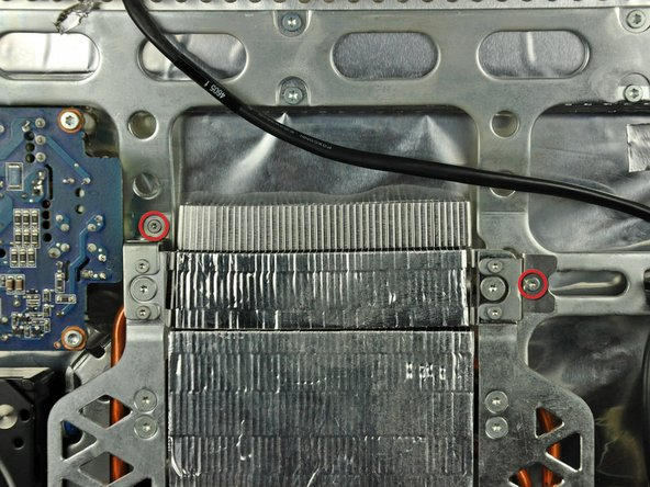 Remove the two T6 Torx screws near the top of the heat sinks.