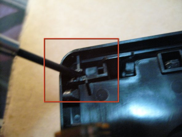Now gently pry the door hinges on either side off of their pivot point, and remove the front door from the assembly