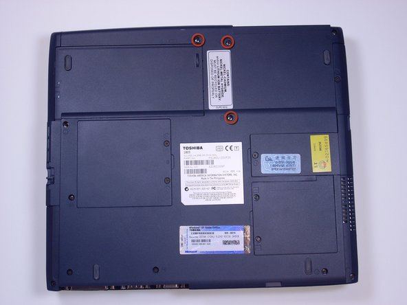 Using a Phillips screwdriver, unscrew and remove 3 B25 screws from the bottom of the laptop.