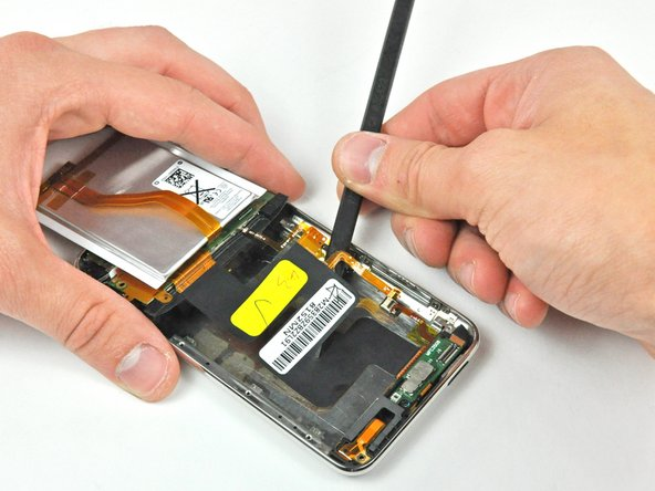Insert the flat end of a spudger between the metal rear panel and Wi-Fi ribbon cable to further loosen the adhesive along the length of the cable.