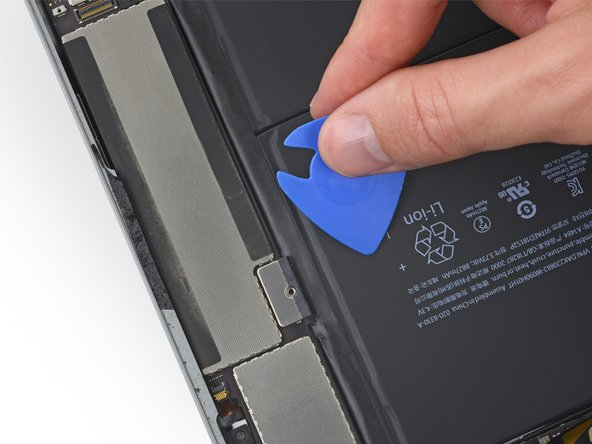 Remove the battery isolation pick.