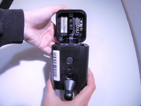 Open Spotlight Cam to remove batteries.