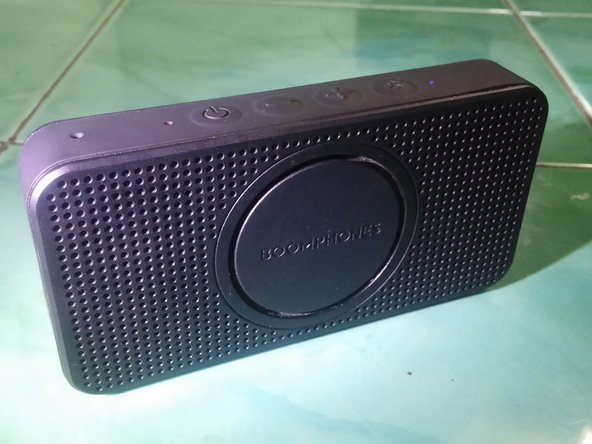The side of this super compact Bluetooth speaker is covered with a rubbery silicone cover.