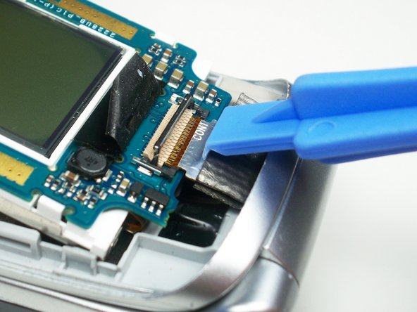 Slide the ribbon cable out of the connector.