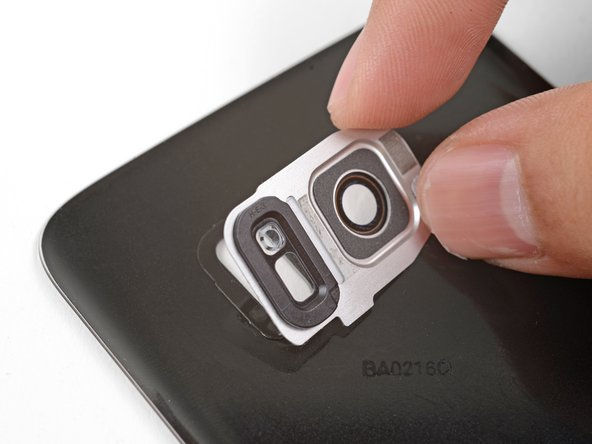 Carefully align and set the bezel over the adhesive.